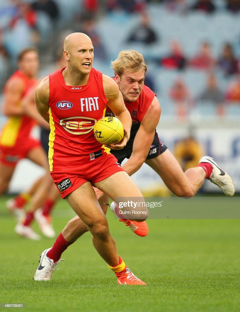 <a gi-track='captionPersonalityLinkClicked' href=/galleries/search?phrase=Gary+Ablett&family=editorial&specificpeople=206196 ng-click='$event.stopPropagation()'>Gary Ablett</a> of the Suns is tackled by Jack Watts of the Demons during the round five AFL match between the Melbourne Demons and the Gold Coast Suns at Melbourne Cricket Ground on April 20, 2014 in Melbourne, Australia.