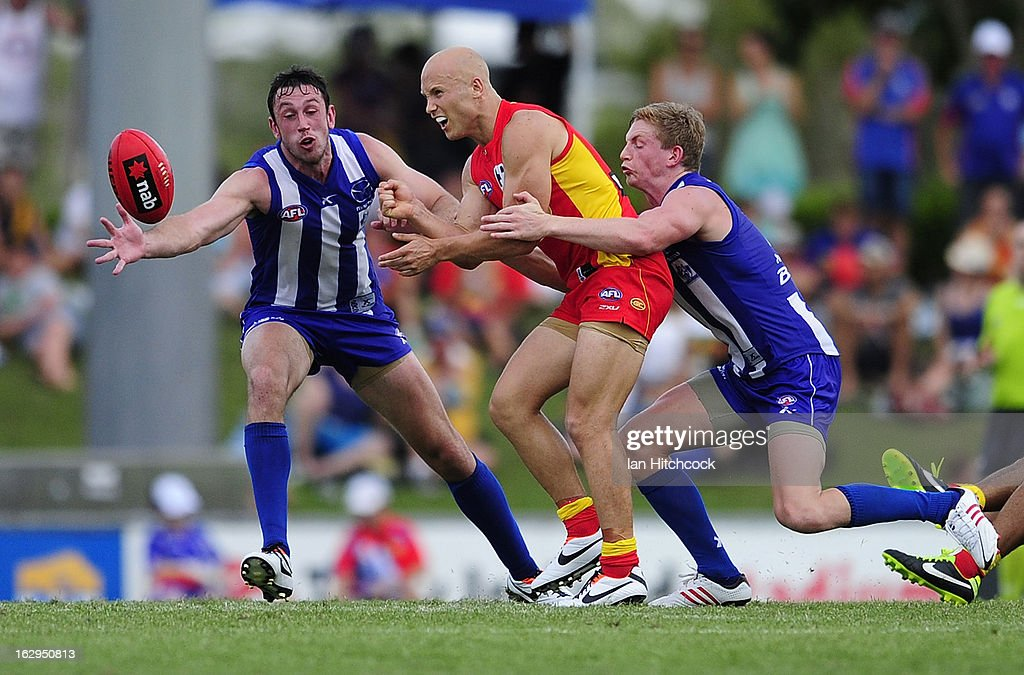 <a gi-track='captionPersonalityLinkClicked' href=/galleries/search?phrase=Gary+Ablett&family=editorial&specificpeople=206196 ng-click='$event.stopPropagation()'>Gary Ablett</a> of the Suns is tackled by Jack Ziebell of the Kangaroos during the round two AFL NAB Cup match between the Gold Coast Suns and the North Melbourne Kangaroos at Tony Ireland Stadium on March 2, 2013 in Townsville, Australia.