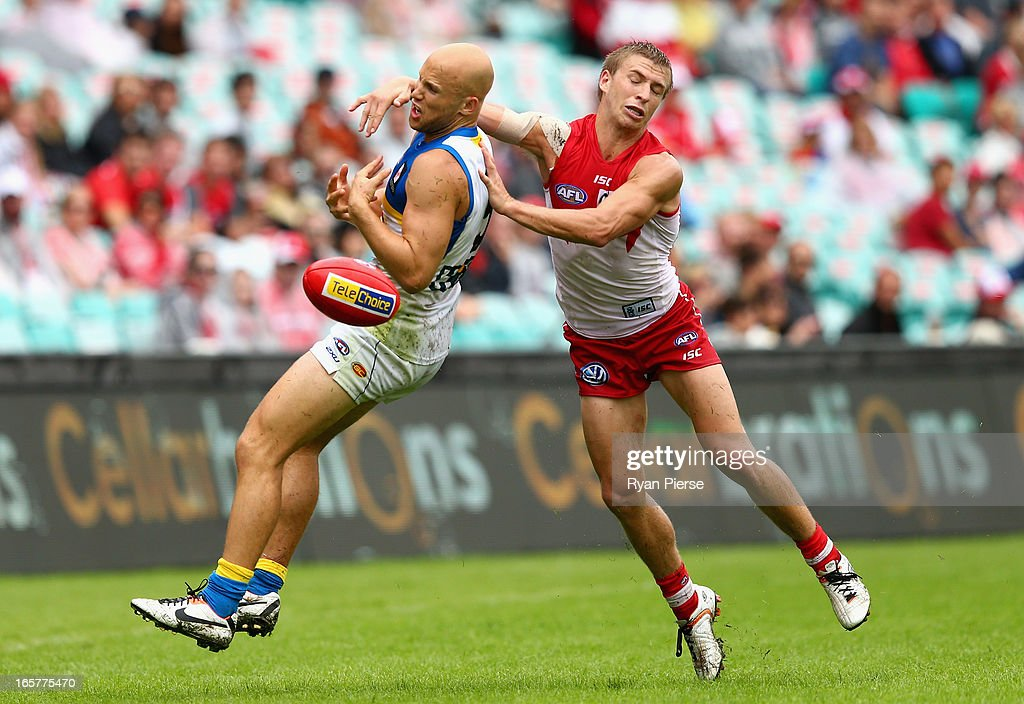 <a gi-track='captionPersonalityLinkClicked' href=/galleries/search?phrase=Gary+Ablett&family=editorial&specificpeople=206196 ng-click='$event.stopPropagation()'>Gary Ablett</a> of the Suns is tackled by Kieren Jack of the Swans during the round two AFL match between the Sydney Swans and the Gold Coast Suns at SCG on April 6, 2013 in Sydney, Australia.