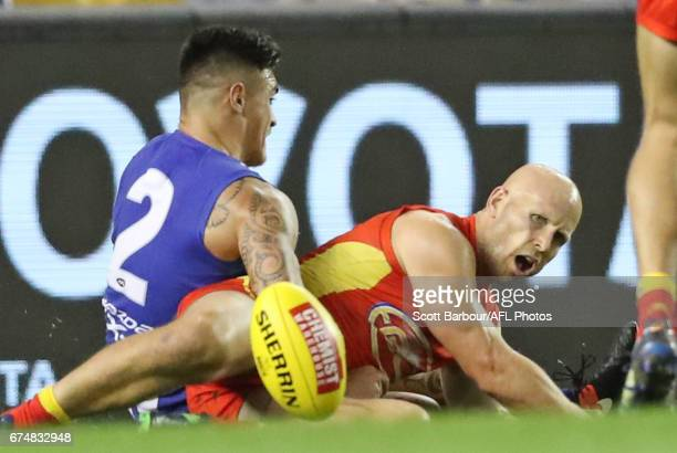 Gary Ablett of the Suns is tackled with the ball by Marley Williams of the Kangaroos which resulted in a free kick and a goal during the round six...