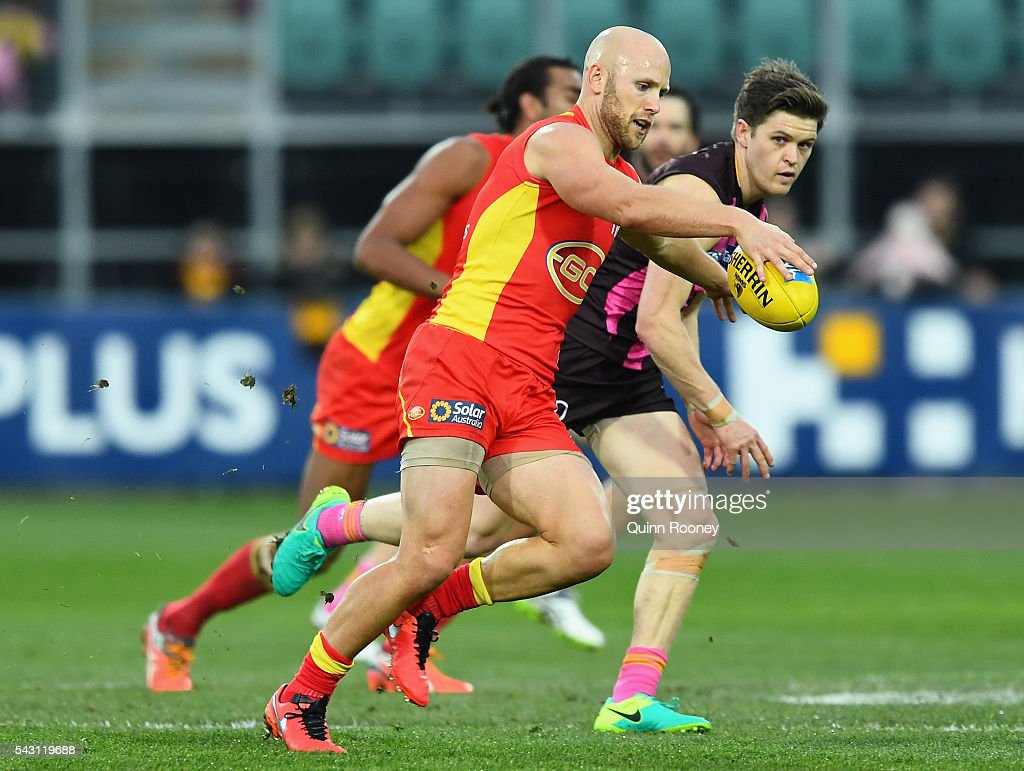 <a gi-track='captionPersonalityLinkClicked' href=/galleries/search?phrase=Gary+Ablett&family=editorial&specificpeople=206196 ng-click='$event.stopPropagation()'>Gary Ablett</a> of the Suns kicks during the round 14 AFL match between the Hawthorn Hawks and the Gold Coast Suns at Aurora Stadium on June 26, 2016 in Launceston, Australia.