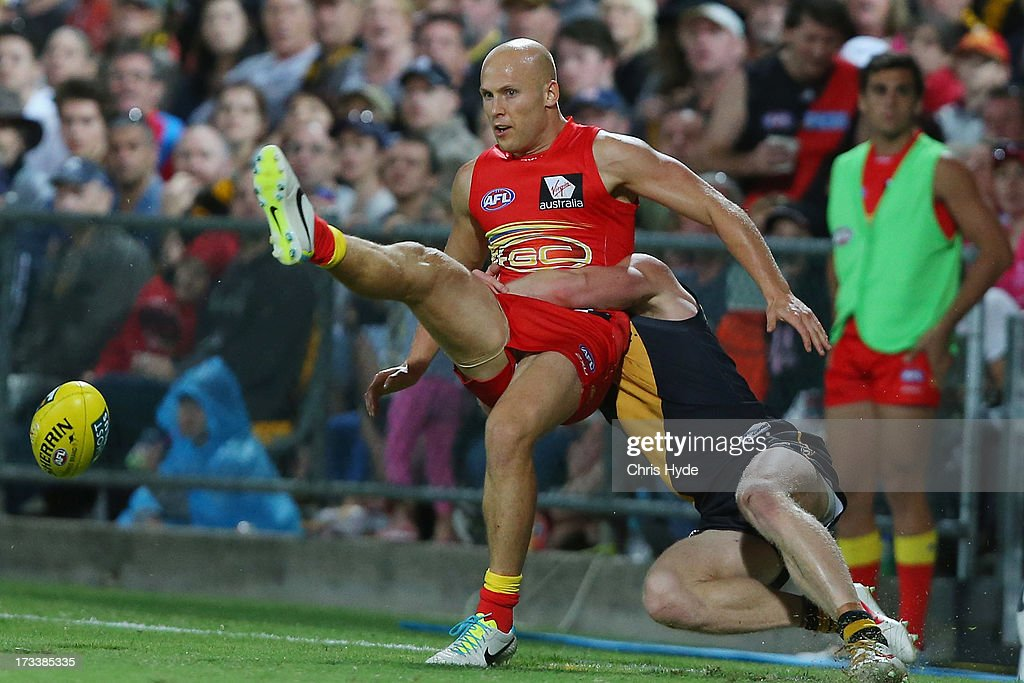 <a gi-track='captionPersonalityLinkClicked' href=/galleries/search?phrase=Gary+Ablett&family=editorial&specificpeople=206196 ng-click='$event.stopPropagation()'>Gary Ablett</a> of the Suns kicks during the round 16 AFL match between the Richmond Tigers and the Gold Coast Suns at Cazaly's Stadium on July 13, 2013 in Cairns, Australia.