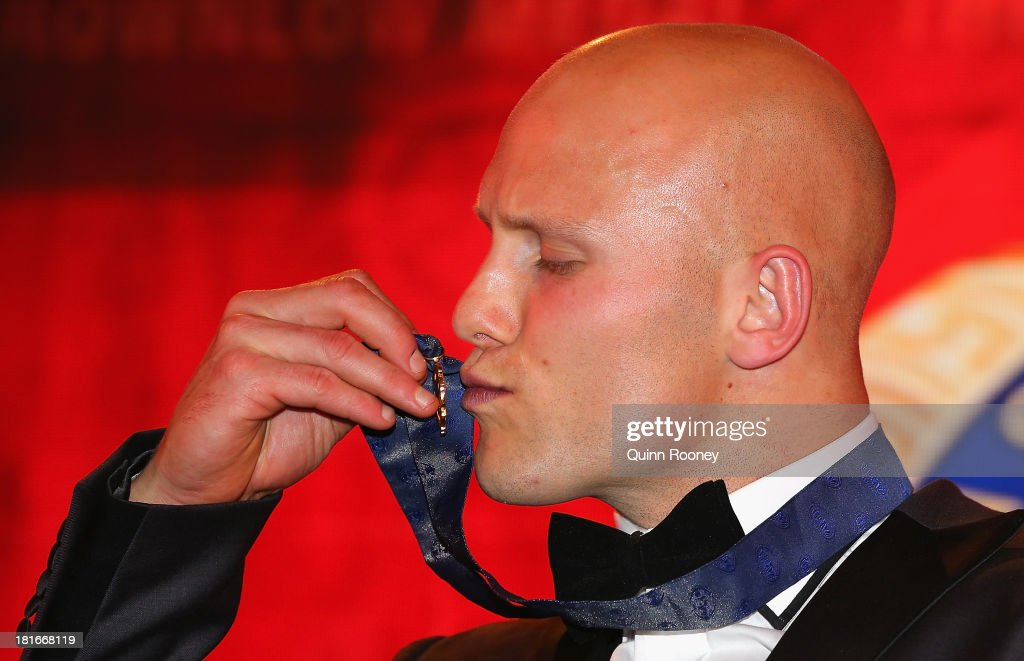<a gi-track='captionPersonalityLinkClicked' href=/galleries/search?phrase=Gary+Ablett&family=editorial&specificpeople=206196 ng-click='$event.stopPropagation()'>Gary Ablett</a> of the Suns kisses the Brownlow Medal after winning the 2013 Brownlow Medal at Crown Palladium on September 23, 2013 in Melbourne, Australia.