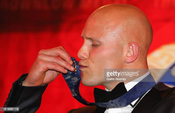 Gary Ablett of the Suns kisses the Brownlow Medal after winning the 2013 Brownlow Medal at Crown Palladium on September 23 2013 in Melbourne Australia