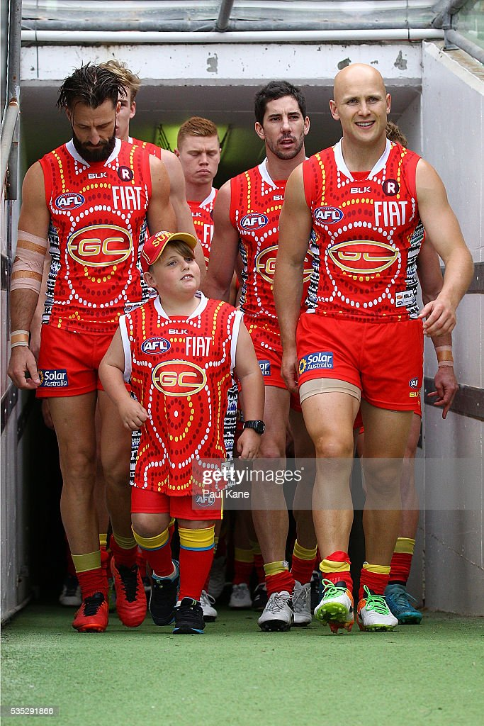 <a gi-track='captionPersonalityLinkClicked' href=/galleries/search?phrase=Gary+Ablett&family=editorial&specificpeople=206196 ng-click='$event.stopPropagation()'>Gary Ablett</a> of the Suns leads his team onto the field during the round 10 AFL match between the West Coast Eagles and the Gold Coast Suns at Domain Stadium on May 29, 2016 in Perth, Australia.