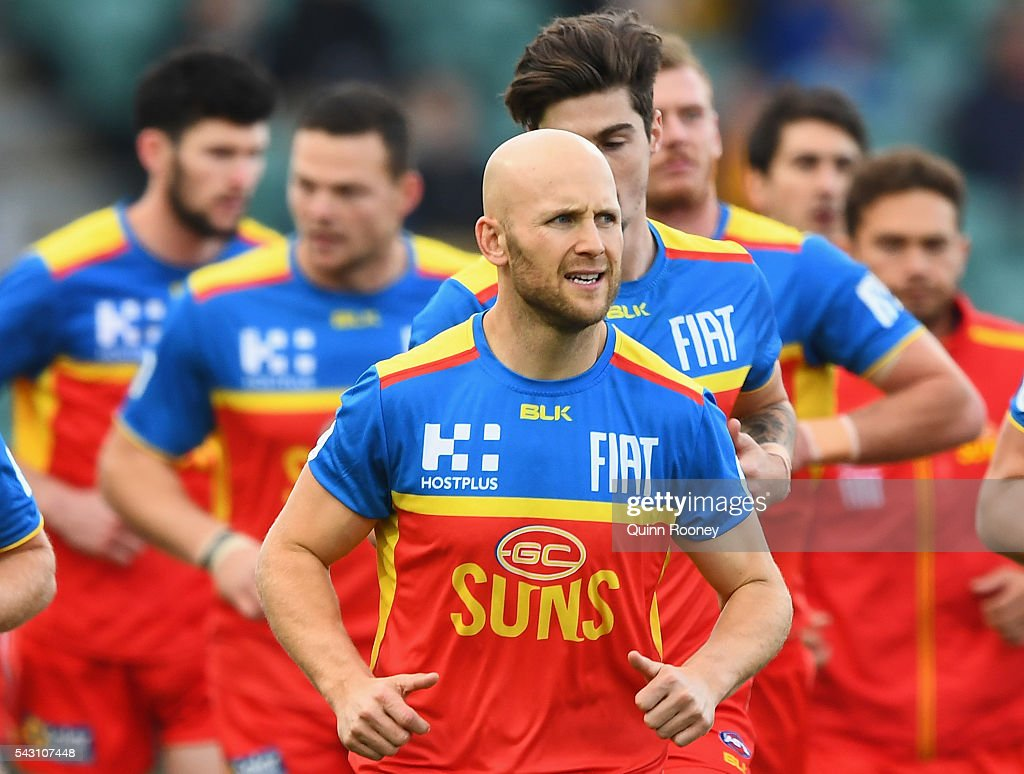 <a gi-track='captionPersonalityLinkClicked' href=/galleries/search?phrase=Gary+Ablett&family=editorial&specificpeople=206196 ng-click='$event.stopPropagation()'>Gary Ablett</a> of the Suns leads his team out for warm up during the round 14 AFL match between the Hawthorn Hawks and the Gold Coast Suns at Aurora Stadium on June 26, 2016 in Launceston, Australia.