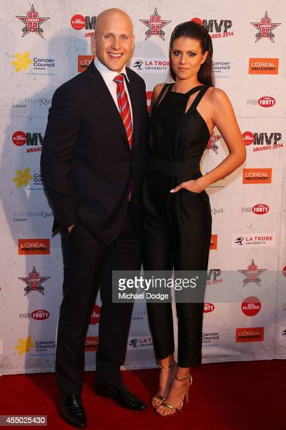 Gary Ablett of the Suns poses with partner Jordan Papalia at the 2014 AFL Players MVP Awards at Shed 14 on September 9 2014 in Melbourne Australia