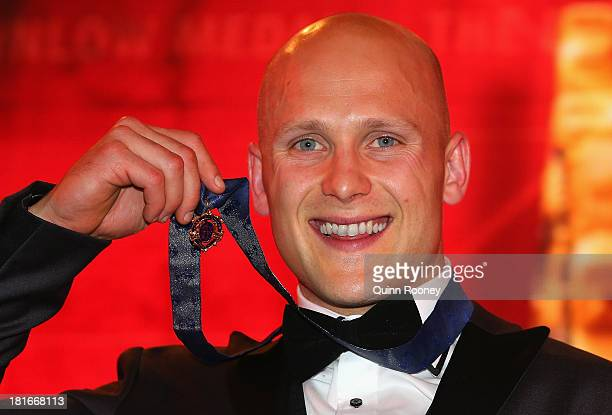 Gary Ablett of the Suns poses with the medal after winning the 2013 Brownlow Medal at Crown Palladium on September 23 2013 in Melbourne Australia