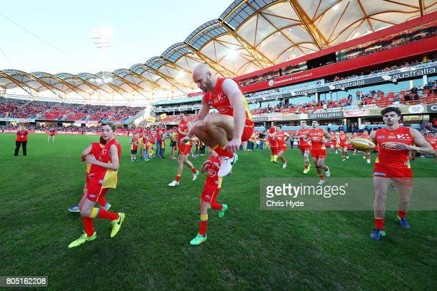Gary Ablett of the Suns runs out for his 300th match during the round 15 the Gold Coast Suns and the North Melbourne Kangaroos at Metricon Stadium on...