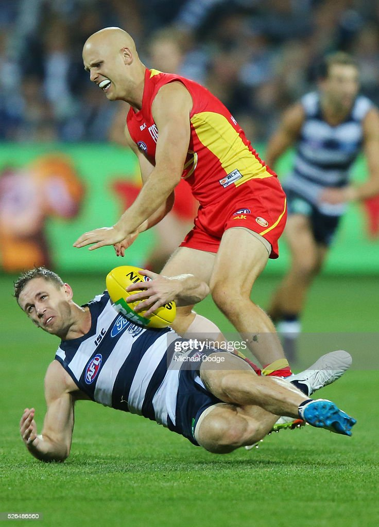 <a gi-track='captionPersonalityLinkClicked' href=/galleries/search?phrase=Gary+Ablett&family=editorial&specificpeople=206196 ng-click='$event.stopPropagation()'>Gary Ablett</a> of the Suns tackles <a gi-track='captionPersonalityLinkClicked' href=/galleries/search?phrase=Joel+Selwood&family=editorial&specificpeople=4521436 ng-click='$event.stopPropagation()'>Joel Selwood</a> of the Cats during the round six AFL match between the Geelong Cats and the Gold Coast Suns at Simonds Stadium on April 30, 2016 in Geelong, Australia.
