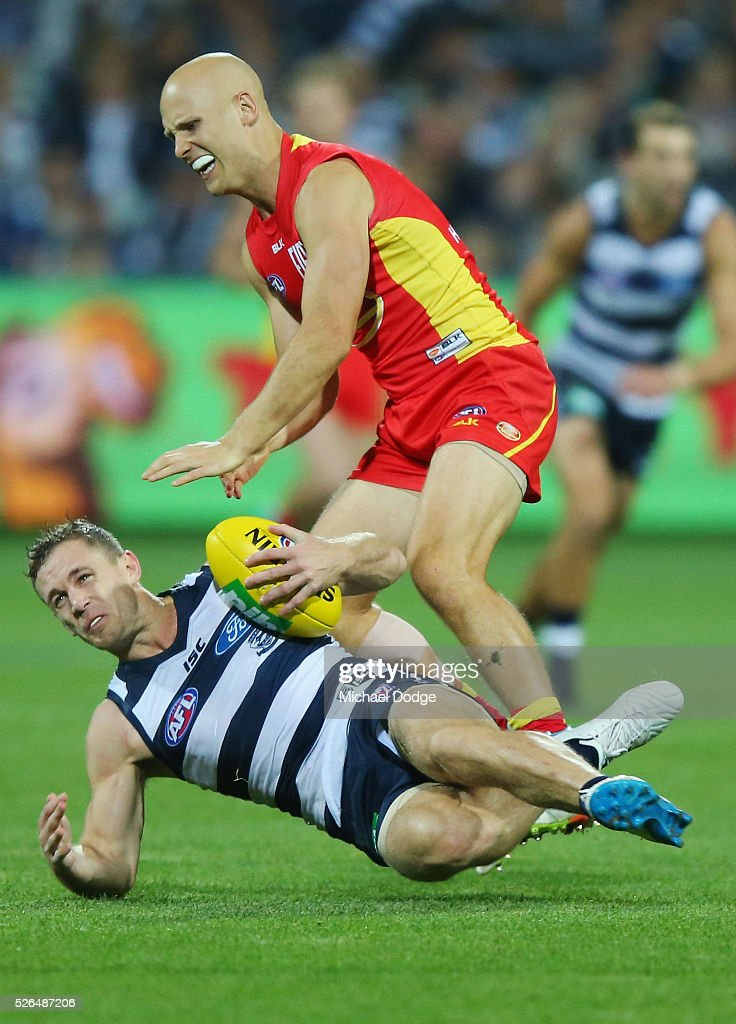 Gary Ablett of the Suns tackles Joel Selwood of the Cats during the round six AFL match between the Geelong Cats and the Gold Coast Suns at Simonds Stadium on April 30, 2016 in Geelong, Australia.
