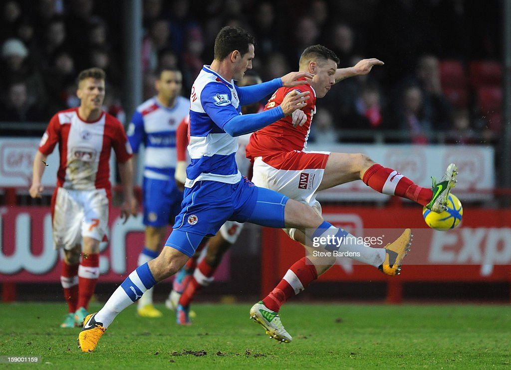 Gary Alexander of Crawley Town is closed down by Sean Morrison of Reading during the FA Cup with Budweiser Third Round match between Crawley Town and Reading at Broadfield Stadium on January 5, 2013 in Crawley, West Sussex.