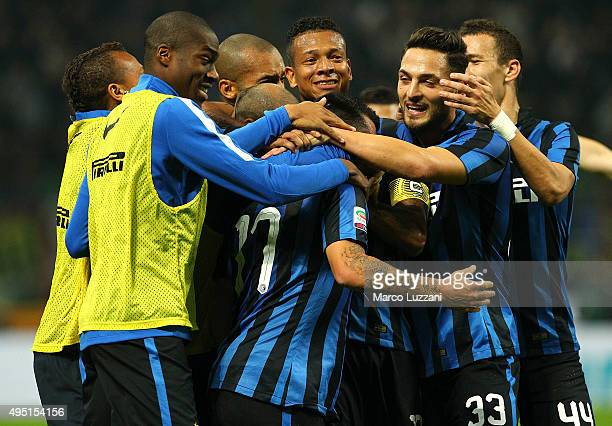 Gary Alexis Medel of FC Internazionale Milano celebrates with his teammates after scoring the opening goal during the Serie A match between FC...