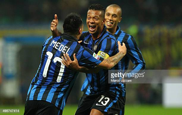 Gary Alexis Medel of FC Internazionale Milano celebrates with his teammate Vasquez Fredy Alejandro Guarin after scoring the opening goal during the...