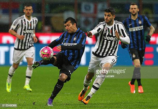 Gary Alexis Medel of FC Internazionale Milano is challenged by Alvaro Morata of Juventus FC during the TIM Cup match between FC Internazionale Milano...