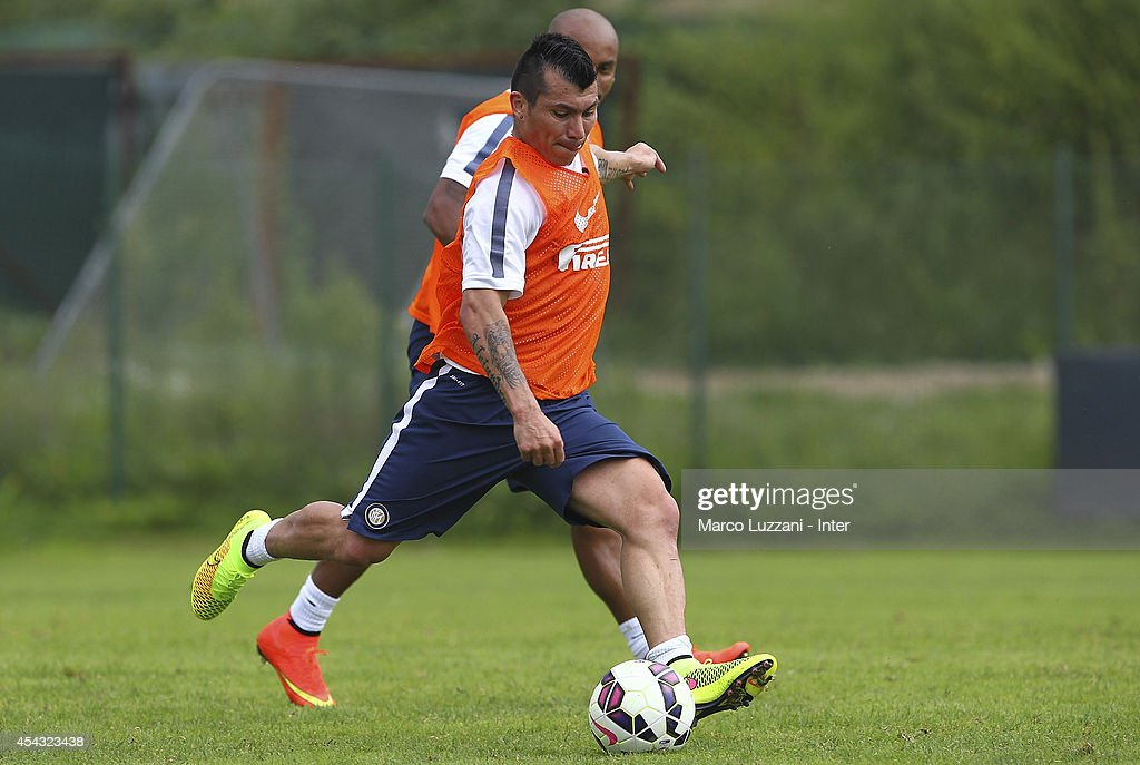 Gary Alexis Medel of FC Internazionale Milano kicks a ball during FC Internazionale Training Session at the club's training ground on August 29, 2014 in Appiano Gentile Como, Italy.