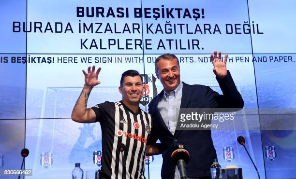 Gary Alexis Medel Soto and Chairman of Besiktas Fikret Orman gesture during press conference after signing a contract for Besiktas for 3 years at...