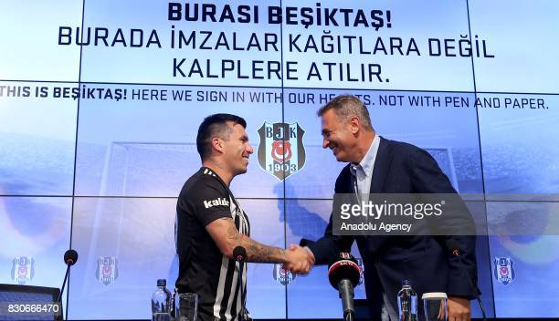 Gary Alexis Medel Soto and Chairman of Besiktas Fikret Orman shake hands during press conference after signing a contract for Besiktas for 3 years at...