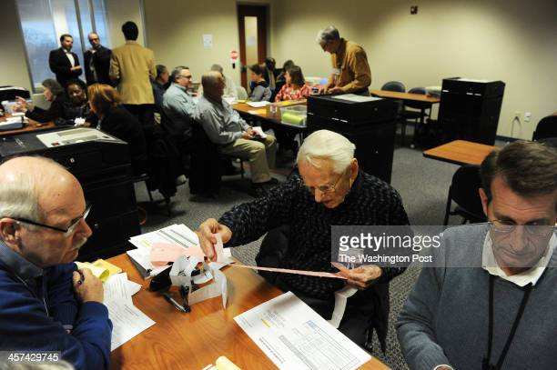 Gary Allen far left Nigel Green center and Jesse Schrum right work during the second day of a recount for attorney general in Virginia at Fairfax...