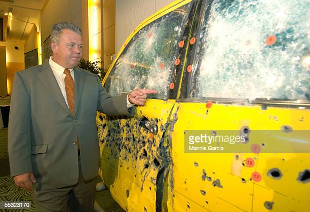 Gary Allen President of Centigon an Armor Holdings Company points to vehicle door riddled with bullet fire September 9 2005 in Washington DC The...
