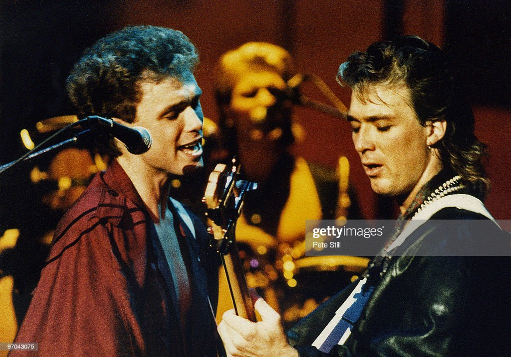 Gary and <a gi-track='captionPersonalityLinkClicked' href=/galleries/search?phrase=Martin+Kemp&family=editorial&specificpeople=213385 ng-click='$event.stopPropagation()'>Martin Kemp</a> of Spandau Ballet perform on stage on the 'Parade' tour at Wembley Arena on December 8th, 1984 in London, England.
