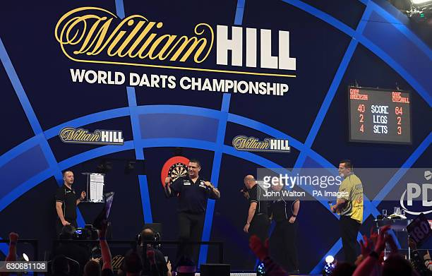 Gary Anderson celebrates defeating Dave Chisnall during day thirteen of the William Hill World Darts Championship at Alexandra Palace London