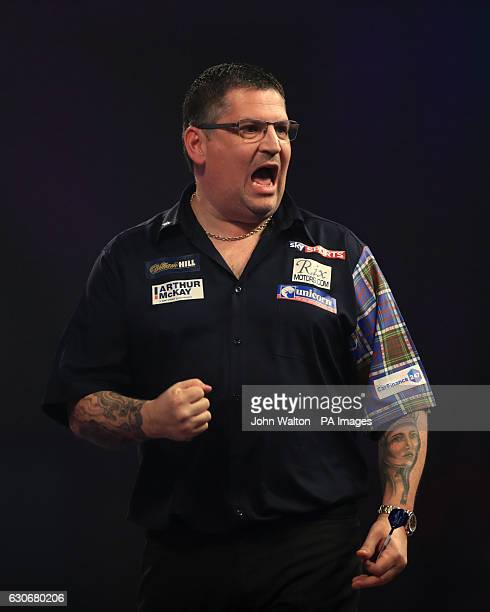 Gary Anderson celebrates during his match against Dave Chisnall during day thirteen of the William Hill World Darts Championship at Alexandra Palace...