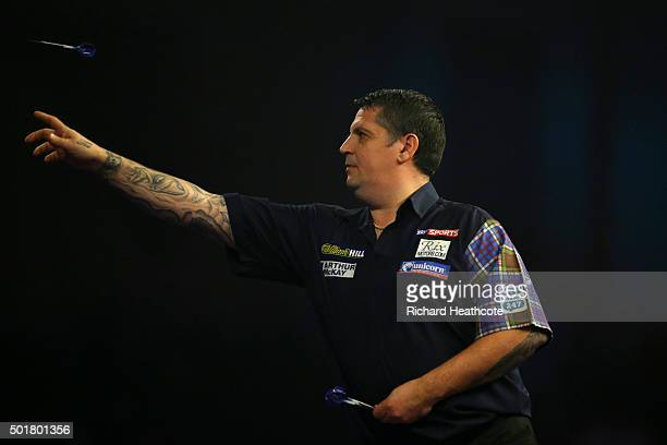 Gary Anderson in action during his first round match against Andy Boulton on day one of the 2016 William Hill PDC World Darts Championships at...