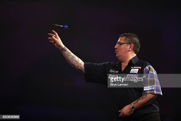 Gary Anderson of Great Britain throws Michael van Gerwen of The Netherlands during the final of the 2017 William Hill PDC World Darts Championships...