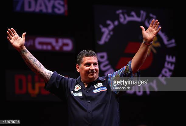 Gary Anderson of Scotland celebrates after winning against James Wade of England during the 2015 Dubai Duty Free Darts Masters QuarterFinal match at...