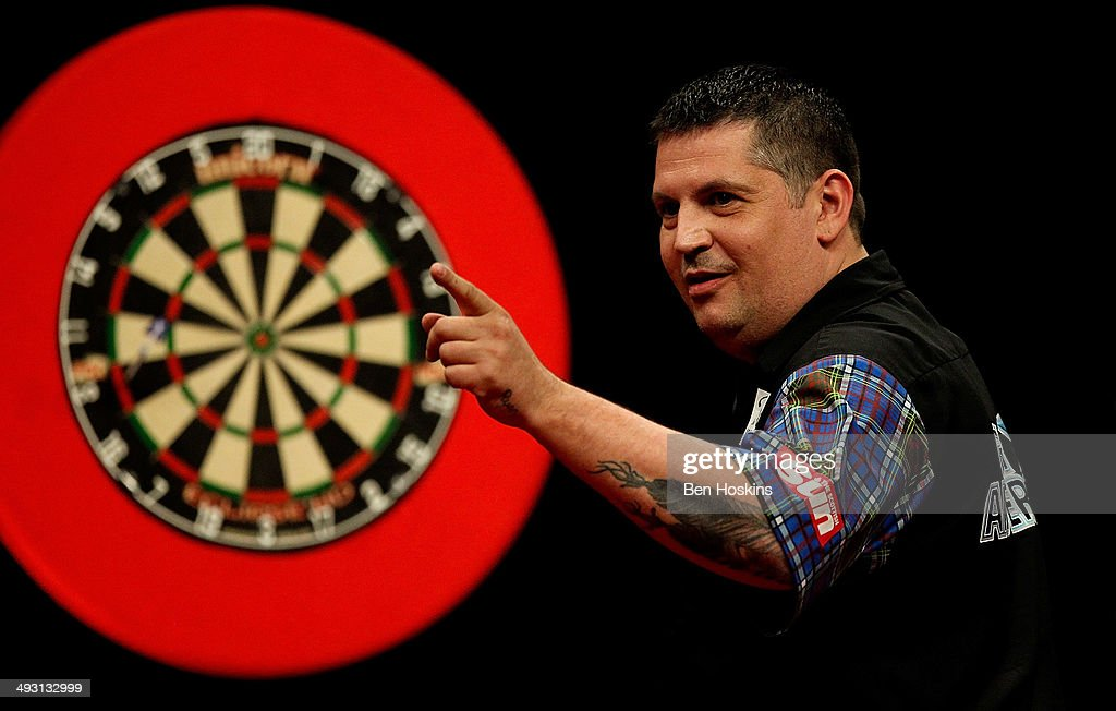 Gary Anderson of Scotland celebrates winning a leg during the McCoys Premier League Darts PlayOffs Semi Final match between Michael van Gerwen and...