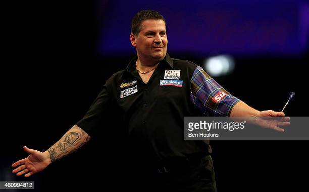 Gary Anderson of Scotland celebrates winning a set during his semi final match against Michael van Gerwen of the Netherlands on day thirteen of the...