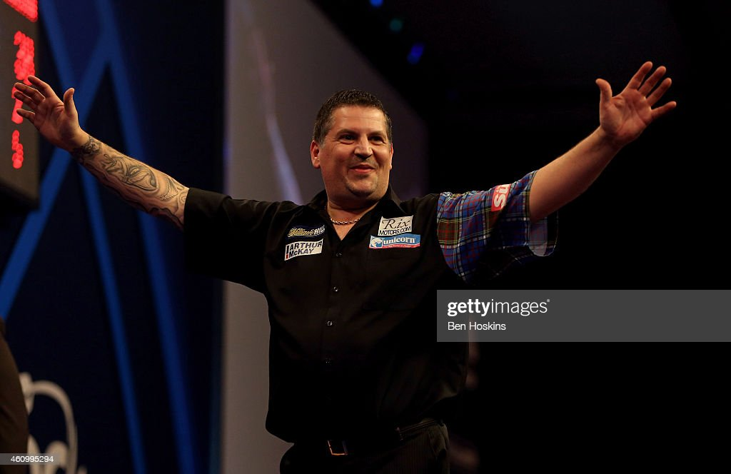 Gary Anderson of Scotland celebrates winning his semi final match against Michael van Gerwen of the Netherlands on day thirteen of the 2015 William...