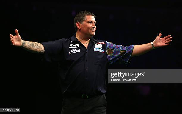 Gary Anderson of Scotland celebrates winning his semifinal match against Dave Chisnall of England during the Betway Premier League at The 02 Arena on...