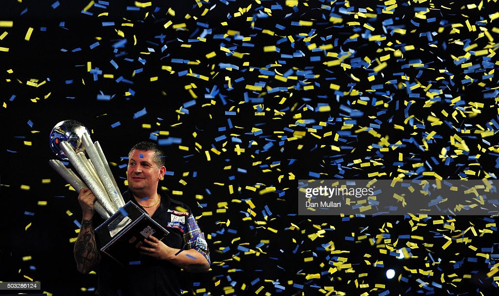 Gary Anderson of Scotland celebrates with the Sid Waddell Trophy after defeating Adrian Lewis of England in the final match during Day Fifteen of the 2016 William Hill PDC World Darts Championships at Alexandra Palace on January 3, 2016 in London, England.