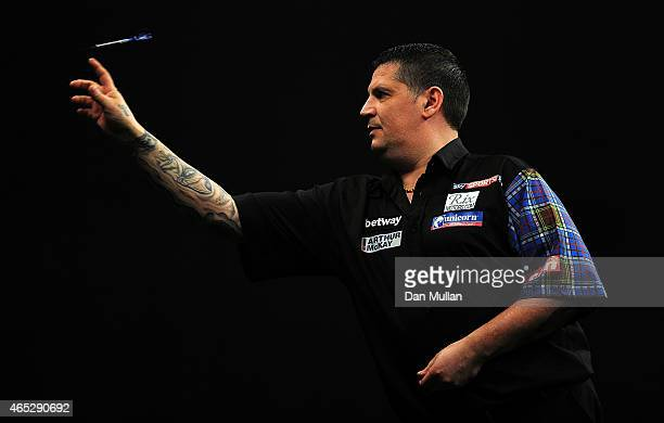 Gary Anderson of Scotland competes against Dave Chisnall of England during The Betway Premier League Darts at Westpoint Arena on March 5 2015 in...