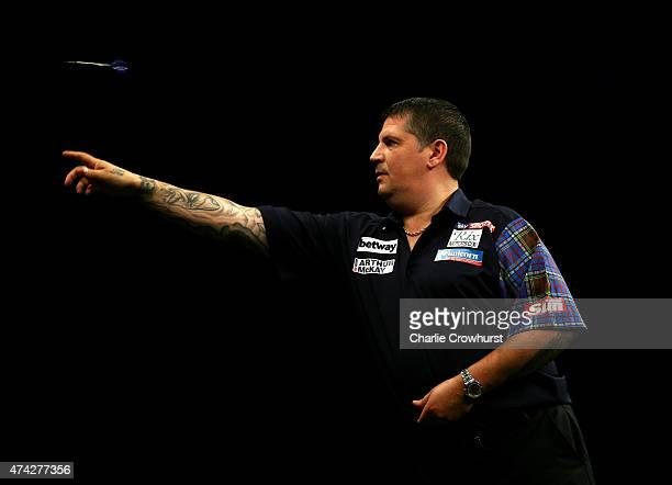 Gary Anderson of Scotland in action during his semifinal match against Dave Chisnall of England during the Betway Premier League at The 02 Arena on...