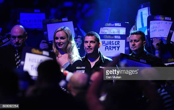 Gary Anderson of Scotland makes his way to the stage for his quarter final match against James Wade of England during Day Thirteen of the 2016...