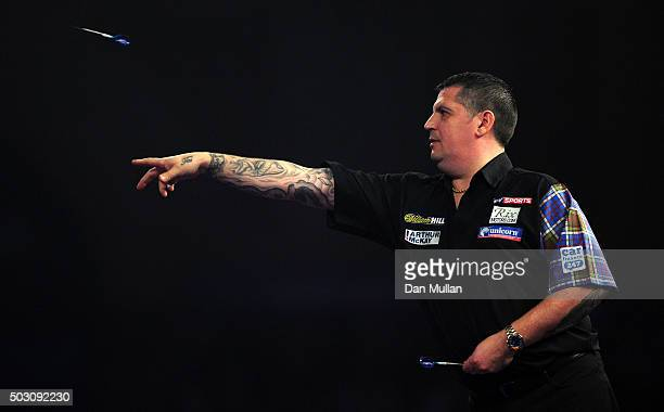 Gary Anderson of Scotland throws during his quarter final match against James Wade of England during Day Thirteen of the 2016 William Hill PDC World...
