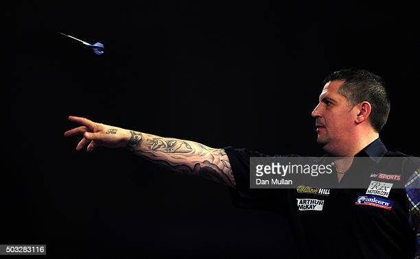 Gary Anderson of Scotland throws during the final match against Adrian Lewis of England during Day Fifteen of the 2016 William Hill PDC World Darts...