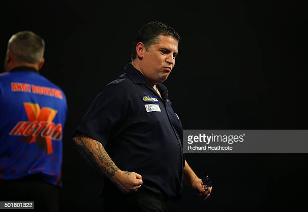 Gary Anderson reacts to winning during his first round match against Andy Boulton on day one of the 2016 William Hill PDC World Darts Championships...
