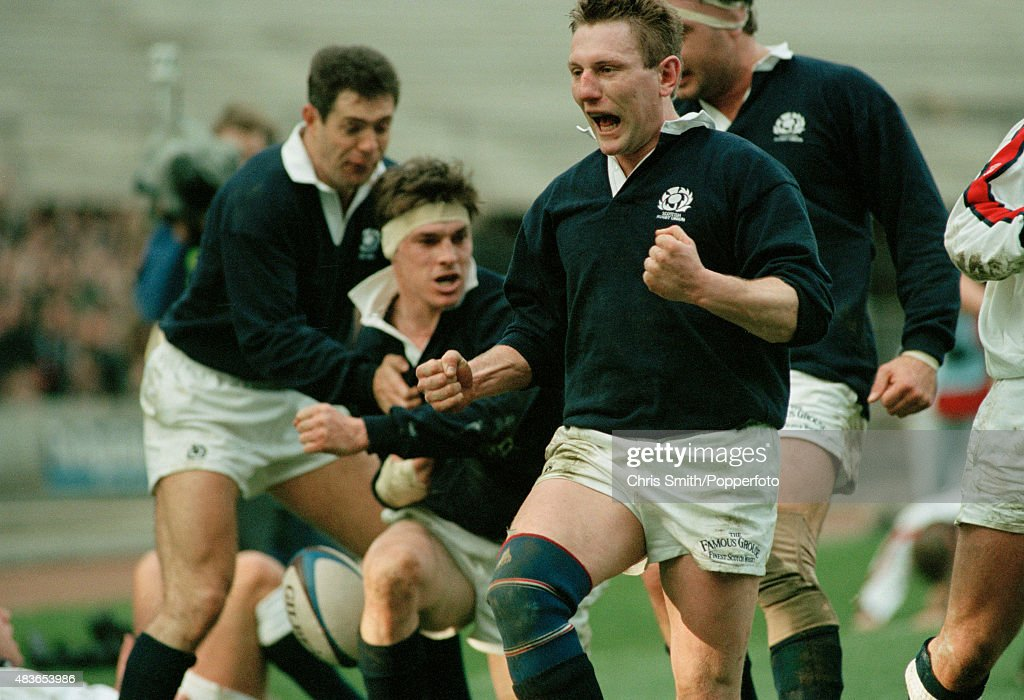 <a gi-track='captionPersonalityLinkClicked' href=/galleries/search?phrase=Gary+Armstrong&family=editorial&specificpeople=234660 ng-click='$event.stopPropagation()'>Gary Armstrong</a> of Scotland (fists clenched) celebrates after <a gi-track='captionPersonalityLinkClicked' href=/galleries/search?phrase=Rob+Wainwright&family=editorial&specificpeople=2724424 ng-click='$event.stopPropagation()'>Rob Wainwright</a> has scored a try during the Rugby Union International between Scotland and England at Murrayfield in Edinburgh on 5th February 1994. England won 15-14.