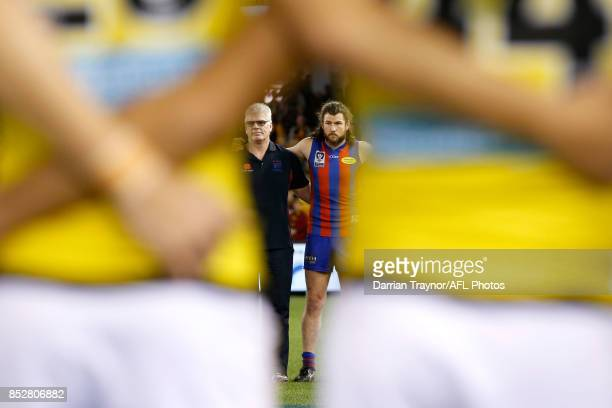Gary Ayres senior coach of Port Melbourne and captain Toby Pinwill stand for the national anthem before the VFL Grand Final match between Richmond...