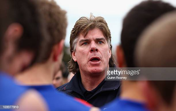 Gary Ayres the coach of Port Melbourne talks to his players during the round 17 VFL match between Port Melbourne and Geelong at Teac Oval on August...