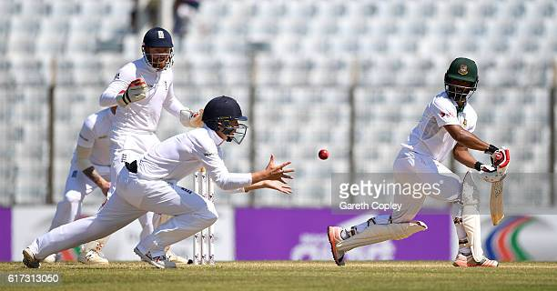 Gary Ballance of England catches out Tamim Iqbal of Bangladesh during the 4th day of the 1st Test match between Bangladesh and England at Zohur Ahmed...