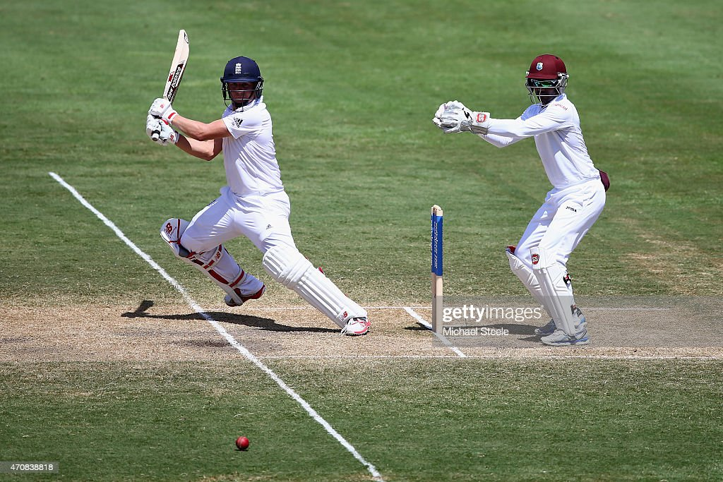 Gary Ballance of England cuts as wicketkeeper Densh Ramdin of West Indieslooks on during day three of the 2nd Test match between West Indies and England at the National Cricket Stadium in St George's on April 23, 2015 in Grenada, Grenada.