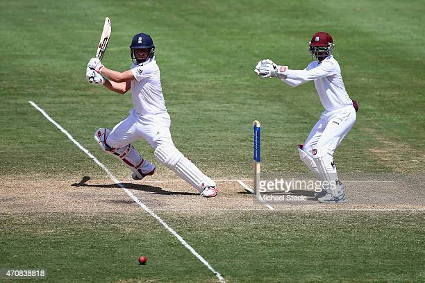 Gary Ballance of England cuts as wicketkeeper Densh Ramdin of West Indieslooks on during day three of the 2nd Test match between West Indies and...