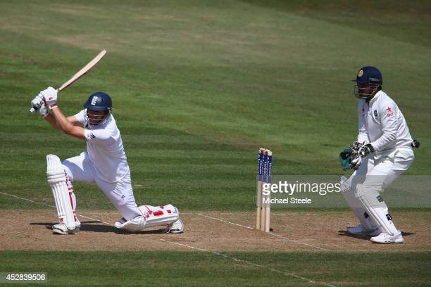 Gary Ballance of England hits a cover drive as wicketkeeper MS Dhoni of India looks on during day two of the 3rd Investec Test match between England...