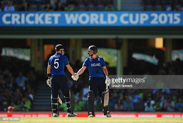 Gary Ballance of England is congratulated by teammate Joe Root after reaching 50 during the ICC Cricket World Cup warm up match between England and...