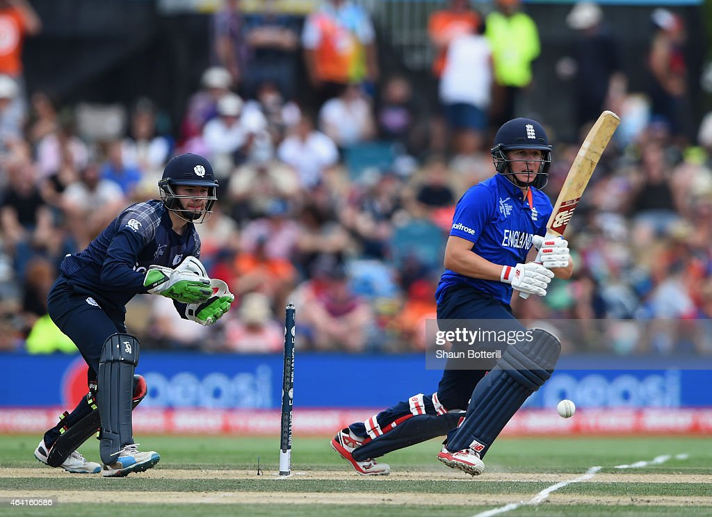 Gary Ballance of England plays a shot as Scotland wicketkeeper Matthew Cross looks on during the 2015 ICC Cricket World Cup match between England and...